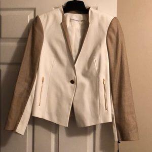 Cream and tweed blazer.